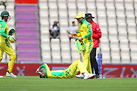 Cricket - 2019 ICC Cricket World Cup warm ups - Australia vs. Sri Lanka<br /> <br /> A laughing Glenn Maxwell helps Steve Smith to his feet after Smith took a ball to the groin whilst fielding during the cricket world cup warm up match at the Hampshire Bowl Southampton England<br /> <br /> COLORSPORT/SHAUN BOGGUST