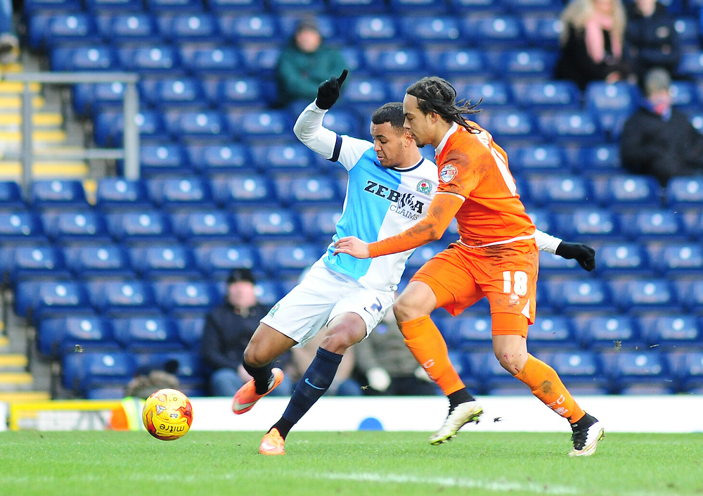 Blackburn Rovers' Joshua King gets in a cross under pressure from Blackpool's Charles Dunne<br /> <br /> Photographer Andrew Vaughan/CameraSport<br /> <br /> Football - The Football League Sky Bet Championship - Blackburn Rovers v Blackpool - Saturday 21st February 2015 - Ewood Park - Blackburn<br /> <br /> © CameraSport - 43 Linden Ave. Countesthorpe. Leicester. England. LE8 5PG - Tel: +44 (0) 116 277 4147 - admin@camerasport.com - www.camerasport.com