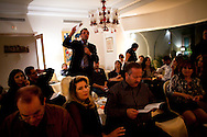 Middle class Tunisian's dicuss their fear of Ennadha taking over their country at a meeting of an independent canidate during the elections.