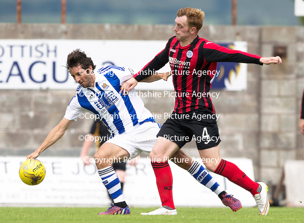 St Johnstone v Real Sociedad...12.07.15  Bayview, Methil (Home of East Fife FC)<br /> Liam Craig back in a saints shirt appearing as a trialist battles with Esteban Granero<br /> Picture by Graeme Hart.<br /> Copyright Perthshire Picture Agency<br /> Tel: 01738 623350  Mobile: 07990 594431
