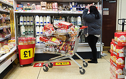 © Licensed to London News Pictures. 21/12/2020. London, UK. A shopper in Iceland supermarket in north London panic-buying for festive groceries, just four days before Christmas day amid a French ban on British hauliers. France closed its border to UK travellers from 11pm last night as London, the South East of England and many parts of the UK went into Tier 4 lockdown as a new variant of the COVID19 virus continues to spread. Photo credit: Dinendra Haria/LNP