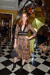 ELLIE BAMBER at a party to celebrate theunveiling of the Claridge's Christmas Tree designed by Christopher Bailey for Burberryheld at Claridge's, Brook Street, London on 18th November 2015.