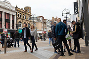 People, some with shopping bags, out and about in the city centres main high street on 4th September, 2021 in Leeds, United Kingdom. Despite a rise in footfall across the UKs high streets, new data has shown more than 8,700 chain stores have closed permanently, with the Covid-19 pandemic seeing consumer habits shifting in favour of shopping online or locally.