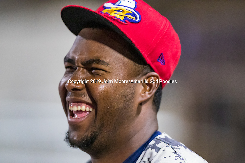 Amarillo Sod Poodles pitcher Dauris Valdez (22) laughs in the dugout during the game against the Northwest Arkansas Travelers on Monday, July 22, 2019, at HODGETOWN in Amarillo, Texas. [Photo by John Moore/Amarillo Sod Poodles]