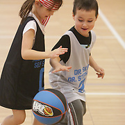 Annabelle Crounse and Robert Fritzsche play during Halo Basketball Saturday December 20, 2014 at Grace United Methodist Church in Wilmington, N.C. (Jason A. Frizzelle)