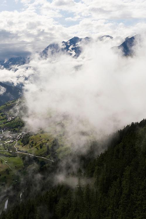 IFTE-NB-007641; Niall Benvie; panorama element; View into the valley around Fliess from Kaunergrat visitor's centre; Austria; Europe; Tirol; vertical; grey blue; forest woodland; 2008; July; summer; fog mist rain cloud; Wild Wonders of Europe Naturpark Kaunergrat