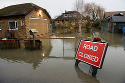 © Licensed to London News Pictures. 03/02/2021. Laleham, UK. A residential property surrounded by flood water in Laleham, Surrey where the Thames has broken it's banks. Large parts of the UK experience more wet conditions which is expected to bring further flooding. Photo credit: Ben Cawthra/LNP