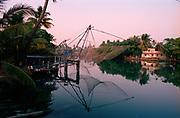Old fishing nets at sunset, Kerala province, India