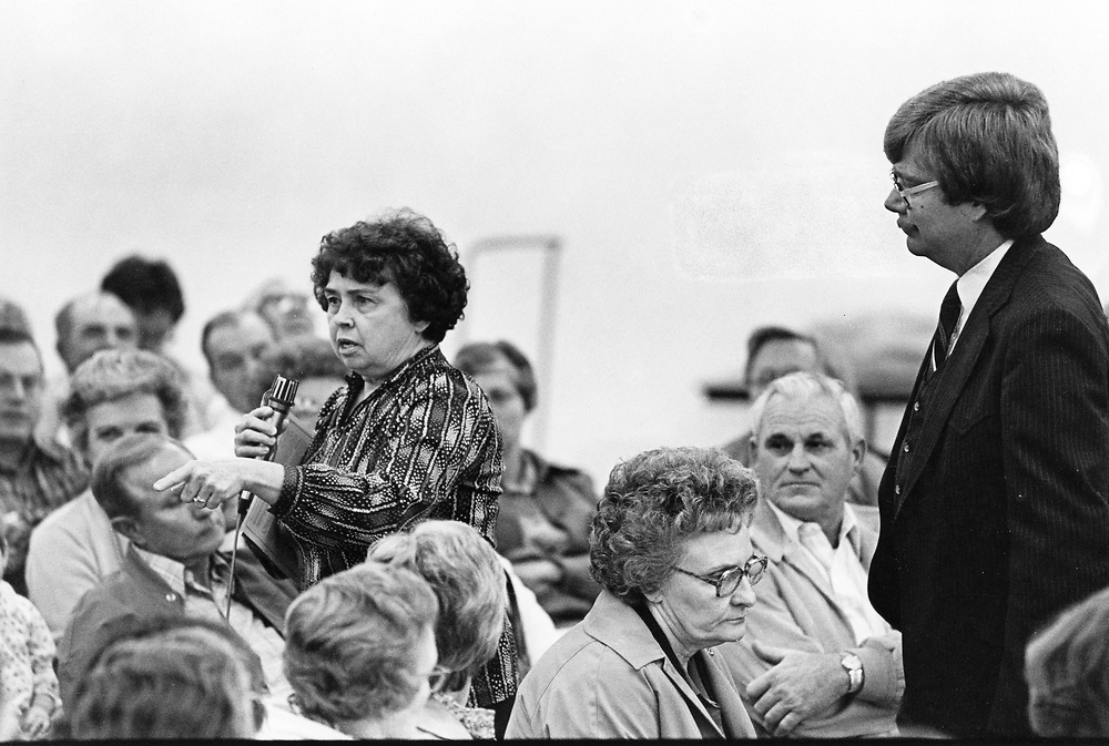 ©1993 Public Speaking:  Woman making a point at neighborhood meeting to discuss airport noise abatement issues. 8410