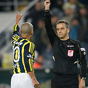 Referee's Mustafa Kamil Abitoglu show the yellow card to Fenerbahce's Alexsandro de Souza during their Turkish superleague soccer match Fenerbahce between Gaziantepspor at the Sukru Saracaoglu stadium in Istanbul Turkey on Monday09 January 2011. Photo by TURKPIX