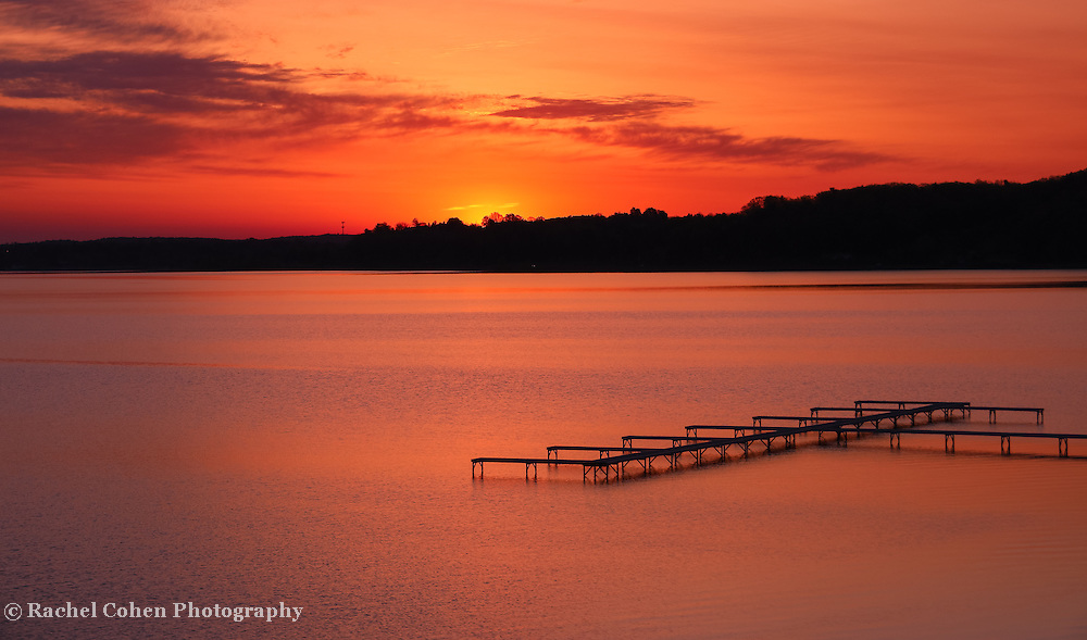 """""""Dawn of fire""""<br /> <br /> A wonderful and fiery sunrise and silhouette in Traverse City Michigan on Grand Traverse Bay!"""