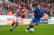 Matty Blair of Doncaster Rovers (17) does his best to escape the attention of. Alex Lacey of Gillingham (4) during the EFL Sky Bet League 1 match between Doncaster Rovers and Gillingham at the Keepmoat Stadium, Doncaster, England on 20 October 2018.