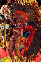 Samba dancer on a float  of the GRES Academicos de Vigario Geral samba school, Carnaval parade in the Sambadrome, Rio de Janeiro, Brazil.