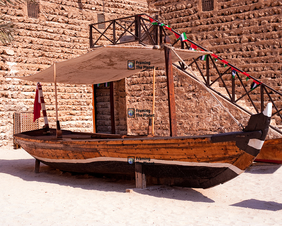 This is an example of one of the small boats used to cross the creek in Dubai. The boat uses traditional wood working techniques and the timbers are sealed with rope in the same way as the more famous dhow. The craft is quite small, only allowing room for five or ten passengers to be shuttled across the creek.