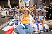 "29 JULY 2010 - PHOENIX, AZ: Jolinda Stephens (CQ), a Unitarian Univeralist from Columbus, OH, and other Unitarians block Washington Street in downtown Phoenix. Dozens of people were arrested during protests against SB 1070 across central Phoenix Thursday. US Judge Susan Bolton's ruling Wednesday stopped four of SB 1070's more than a dozen provisions from going into effect. She wrote, ""The court also finds that the United States is likely to suffer irreparable harm if the court does not preliminarily enjoin enforcement of these sections,"" she states in the ruling. ""The balance of equities tips in the United States' favor considering the public interest.""   PHOTO BY JACK KURTZ"