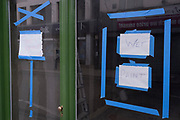 A detail of a 'Wet Paint' warning sign, on a high-street shop window, on 25th July 2021, in Whitstable, Kent, England.