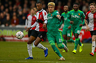Watford forward Adalberto Peñaranda (17) and Woking defender Nathan Collier (2) challenge for the ball during the The FA Cup 3rd round match between Woking and Watford at the Kingfield Stadium, Woking, United Kingdom on 6 January 2019.