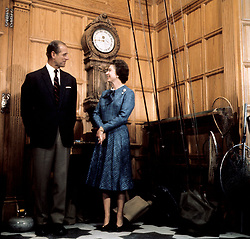File photo dated 26/09/76 of Queen Elizabeth II and the Duke of Edinburgh during their traditional summer break at Balmoral Castle. The Royal couple will celebrate their platinum wedding anniversary on November 20.