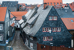 View of traditional houses in Goslar with slate tile son the roof and walls, Lower Saxony, Germany