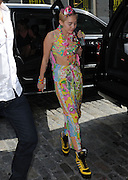 Sept. 10, 2014 - New York, New York, U.S. - <br /> <br /> Miley Cyrus 'Dirty Hippie' New York Launch<br /> <br /> MILEY CYRUS wears a floral island fruit inspired wrap pants, tube top and custom adidas high top shoes on her way to J. Scottís Spring/Summer 2015 runway show where her art collection, Dirty Hippie was unveiled.<br /> ©Exclusivepix
