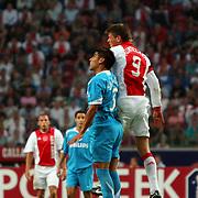 NLD/Amsterdam/20070811 - 12de Johan Cruijff Schaal, Ajax - PSV, Klaas Jan Huntelaar in duel met Carlos Salcido