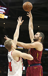 October 24, 2017 - Cleveland, OH, USA - The Cleveland Cavaliers' Kevin Love puts up a first-quarter shot as the Chicago Bulls' Lauri Markkanen defends on Tuesday, Oct. 24, 2017, at Quicken Loans Arena in Cleveland. (Credit Image: © Phil Masturzo/TNS via ZUMA Wire)