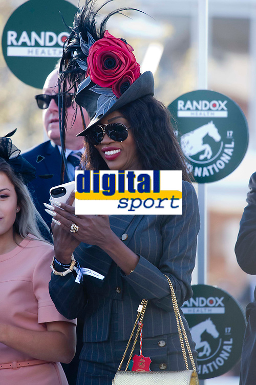 National Hunt Horse Racing - 2017 Randox Grand National Festival - Saturday, Day Three [Grand National Day]<br /> <br /> Unidentified black female partner of one of the owners of 3rd placed Saint Are,  on the podium dressed in extravagant hat with long nails at the presentation he Randox Health Grand National  at Aintree Racecourse.<br /> <br /> COLORSPORT/WINSTON BYNORTH<br /> <br /> <br /> <br /> <br /> <br /> <br /> <br /> <br /> <br /> <br /> National Hunt Horse Racing - 2017 Randox Grand National Festival - Saturday, Day Three [Grand National Day]<br /> <br />  in the 1st race the 1.45 Gaskells Handicap Hurdle at Aintree Racecourse.<br /> <br /> COLORSPORT/WINSTON BYNORTH