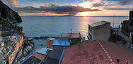 """A panoramic view of the Marina of Riomaggiore at sunset. Taken from the terrace of the bed & breakfast """"La Baia di Rio"""". Riomaggiore is the eastern most among the five medieval small villages altogether known as Cinque Terre in the Italian Riviera, Liguria, Italy"""