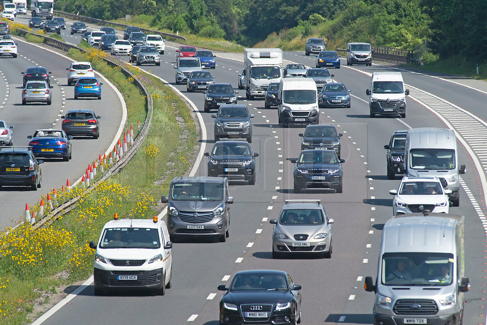 © Licensed to London News Pictures 23/07/2021. Swanley, UK. Heavy getaway traffic on the M25 in Kent near Swanley. As the heatwave weather continues today in the UK thousands of motorists head off for their family summer getaway. Photo credit:LNP