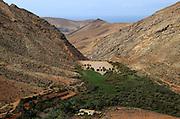 Dam and reservoir partially silted up by sediment, Presa de la Penitas, Fuerteventura, Canary Islands, Spain