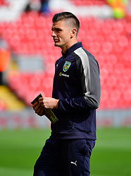 Burnley goalkeeper Nick Pope inspects the pitch before the game