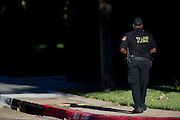 A private security guard on patrol at the apartment complex where a third Ebola patient lives in Dallas, Texas on October 15, 2014. (Cooper Neill for The New York Times)