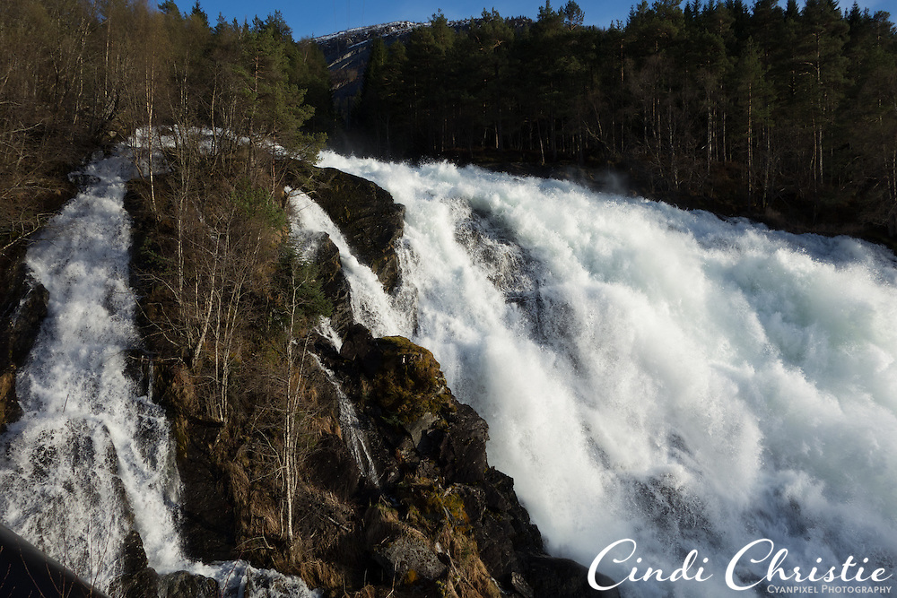 Eidsfossen, a large waterfall near Sandane, Norway, helps generate electricity on May 13, 2013. Waterfalls were running at full force as warm temperatures arrived in the area.  (© 2013 Cindi Christie)