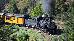 The train is captured as it approaches the Million Dollar Highway overpass.