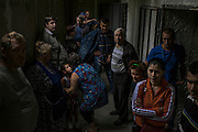 Makiivka, Ukraine - August 19, 2014: Civilians wait in a bomb shelter after heavy shelling by Ukrainian troops in Makiivka, some 15km east of Donetsk. CREDIT: Photo by Mauricio Lima for The New York Times