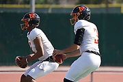 Los Angeles Wildcats quarterbacks Jalen McClendon (2) and Charles Kanoff (3) throw the ball during practice, Wednesday, Feb. 5, 2020, in Long Beach, Calif. The Wildcats are part of the eight-team XFL, a professional American football league owned by Vince McMahon's Alpha Entertainment, with  headquarters in Stamford, Connecticut. It is the successor to the original XFL, which was controlled by the World Wrestling Federation (WWF, now WWE)  and NBC, and ran for a single season in 2001.
