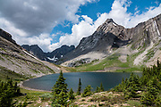 Mount Maude rises above Maude Lake at North Kananaskis Pass. Day hike from Forks Campground to North Kananaskis Pass (13 miles round trip/2700 ft) in Peter Lougheed Provincial Park, Kananaskis Country, Alberta, Canada.