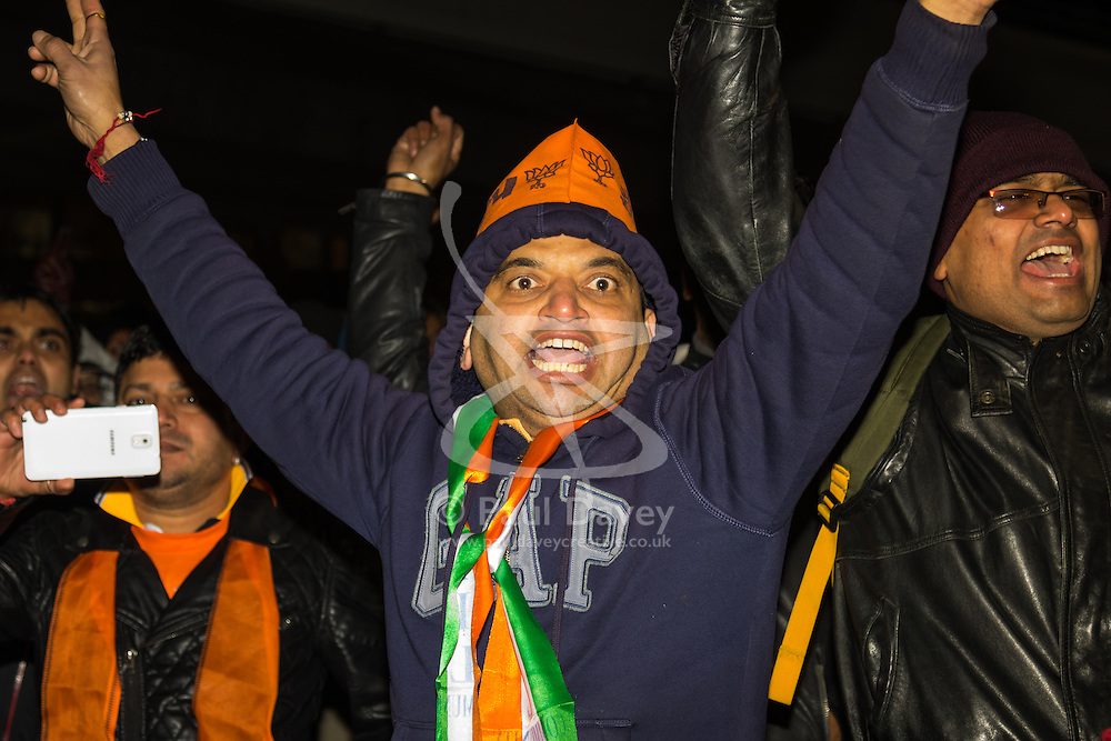 "Amid high security measures, hundreds of Kashmiri protesters  outside Wembley Stadium after an address to more than 60,000 Indian expats by Prime Minister Narendra Modi at a 'UK Welcomes Modi' reception. Modi, a Hindu and his BJP party are accused of a wide range of human rights abuses against religious and ethnic minorities in India. PICTURED: Pro-Modi Indians chant ""Modi,Modi, Modi"" as they pass by Kashmiri protesters as they leave Wembly Stadium."