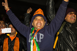 """Amid high security measures, hundreds of Kashmiri protesters  outside Wembley Stadium after an address to more than 60,000 Indian expats by Prime Minister Narendra Modi at a 'UK Welcomes Modi' reception. Modi, a Hindu and his BJP party are accused of a wide range of human rights abuses against religious and ethnic minorities in India. PICTURED: Pro-Modi Indians chant """"Modi,Modi, Modi"""" as they pass by Kashmiri protesters as they leave Wembly Stadium."""