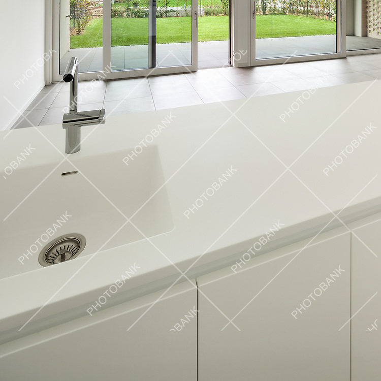 Interior, modern domestic kitchen, white counter top