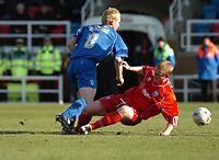 Photo: Ian Hebden.<br />Rushden & Diamonds v Grimsby Town. Coca Cola League 2. 04/03/2006.<br />Grimsbys Paul Bolland (L) slips the ball past Rushdens Ronnie Bull (R).
