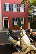 Vespa scooters parked outside a historic home in Charleston, SC.