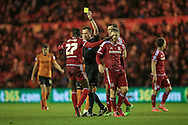 Albert Adomah (Middlesbrough) receives a yellow card from James Linington (referee) for a challenge during the Sky Bet Championship match between Middlesbrough and Wolverhampton Wanderers at the Riverside Stadium, Middlesbrough, England on 4 March 2016. Photo by Mark P Doherty.