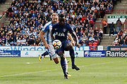 Davinson Sánchez of Tottenham under pressure from Huddersfield Town's Laurent Depoitre during the Premier League match between Huddersfield Town and Tottenham Hotspur at the John Smiths Stadium, Huddersfield, England on 30 September 2017. Photo by Paul Thompson.