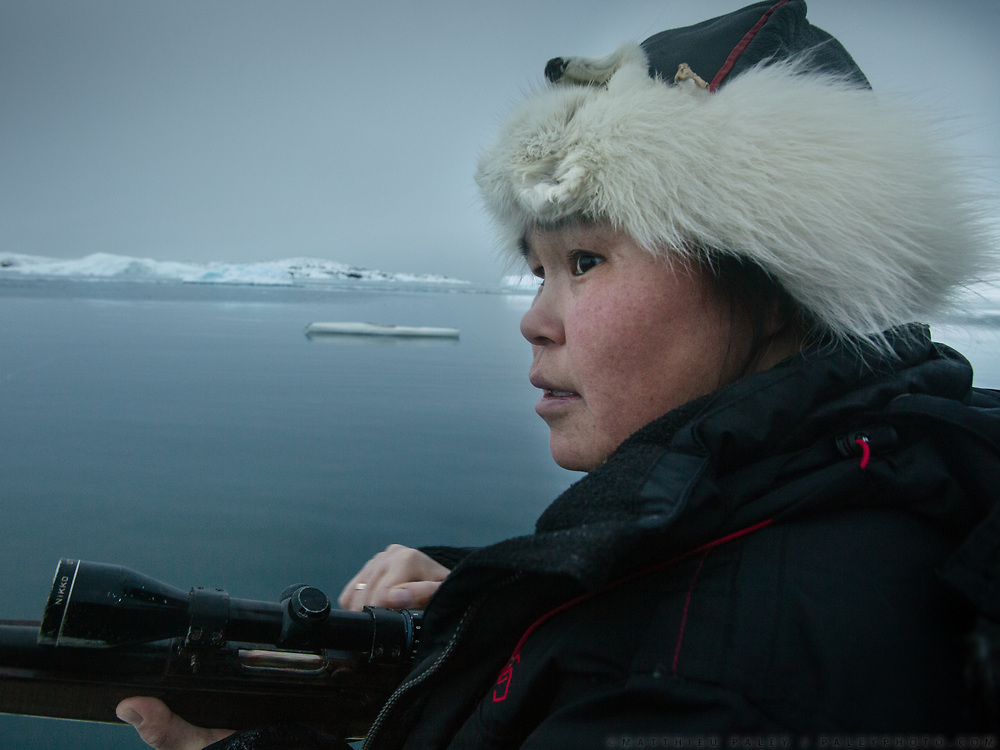Going seal hunting, on a boat, with Bent and Dina Igniatiussen. Life in and around the small Inuit settlement of Isortoq (population of 64), in East Greenland.