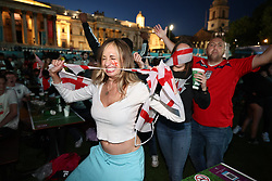 © Licensed to London News Pictures. 07/07/2021. London, UK. England fans celebrate going 2-1 up. England fans gather at the Fan Zone in Trafalgar Square, central London, for the Euro 2020 semi final between England and Denmark. England are attempting to reach their first final since 1966. Photo credit: Ben Cawthra/LNP