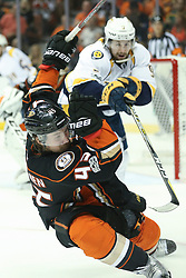 May 20, 2017 - Anaheim, California, U.S. - Anaheim Ducks defenseman JOSH MANSON is taken down from behind by Nashville Predators center FILIP FORSBERG, leading to a Ducks power play in the second period, during the Stanley Cup Western Conference Finals, Round 3, Game 5, at the Honda Center. (Credit Image: © Peter Joneleit/CSM via ZUMA Wire)