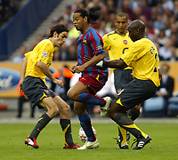 Photo: Chris Ratcliffe.<br /> Arsenal v Barcelona. UEFA Champions League Final. 17/05/2006.<br /> Ronaldinho is surrounded by Robert Pires and Sol Campbell