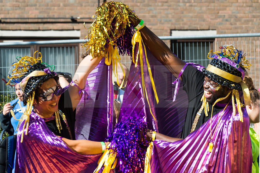 © Licensed to London News Pictures. 27/08/2017. London, UK. Carnival dancers parade on the first day of Notting Hill Carnival in west London. It is second largest street festival in the world after the Rio Carnival in Brazil, attracting over 1 million people. Photo credit: Ray Tang/LNP