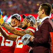 KANSAS CITY, MO - JANUARY 19: Tyrann Mathieu #32 of the Kansas City Chiefs holds up the Lamar Hunt trophy in front of Patrick Mahomes #15 of the Kansas City Chiefs after defeating the Tennessee Titans in the AFC Championship Game at Arrowhead Stadium on January 19, 2020 in Kansas City, Missouri. The Chiefs defeated the Titans 35-24. (Photo by David Eulitt/Getty Images)